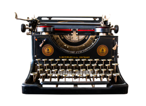 A photograph of a manual typewriter. Image by Gerhard G. on Pixabay.
