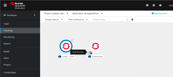 The topology view in the OpenShift console shows that the application image is being built in OpenShift cluster.